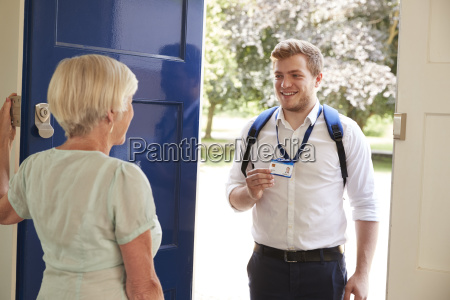 senior woman opens door to male