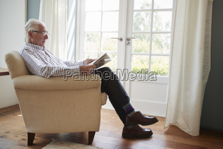 senior man sitting in an armchair