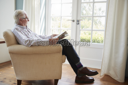 senior man sitting in an armchair