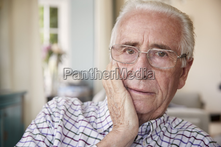 worried senior man at home looking