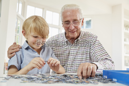 senior man and grandson doing a