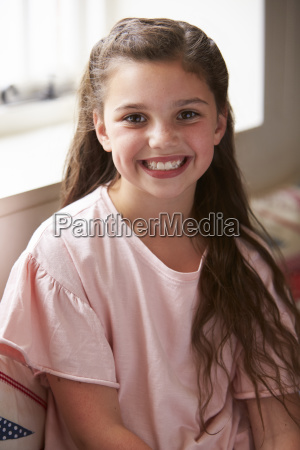 portrait of smiling young girl sitting