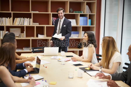 young male manager standing at a