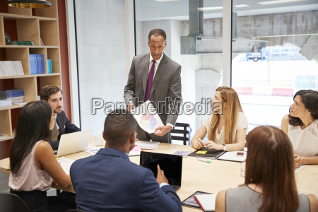 male boss holding document at a
