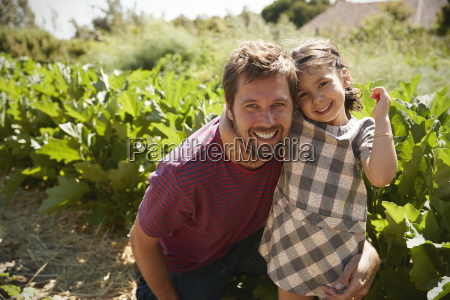 portrait of father and daughter standing