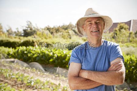 portrait of mature man standing on