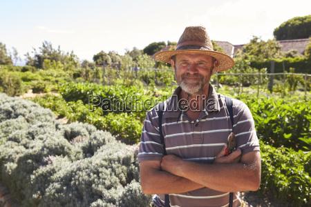 portrait of mature man standing in