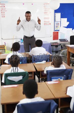 teacher in front of classroom of
