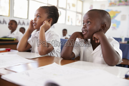 two kids listening during a lesson