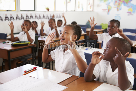 kids showing hands during a lesson