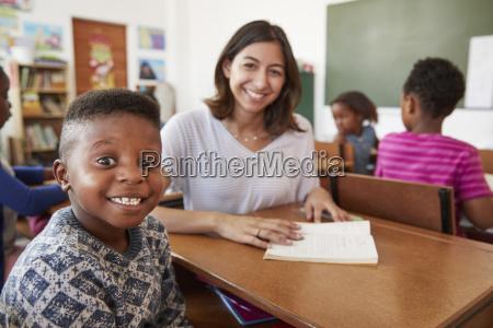 female teacher and elementary school boy