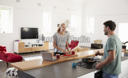 couple preparing meal together in modern