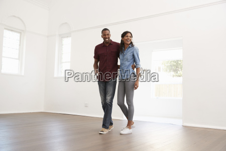 excited young couple moving into new
