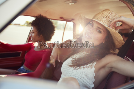 portrait of friends relaxing in car
