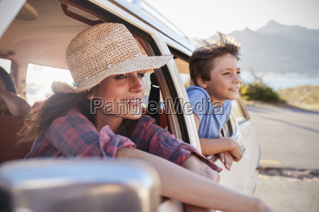 mother and children relaxing in car
