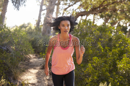 young black woman jogging in a