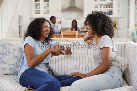 mother talking with teenage daughter on