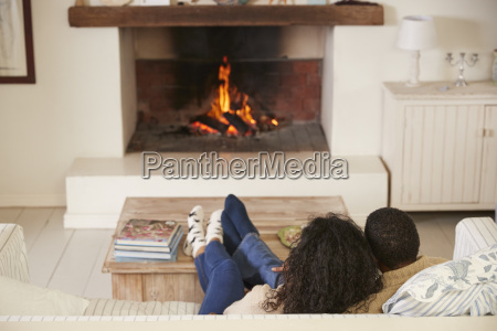 romantic couple relaxing in lounge next