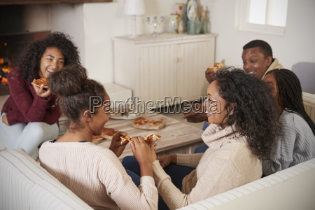 family sitting on sofa in lounge