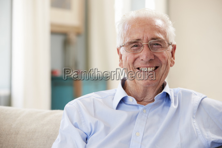 portrait of smiling senior man sitting