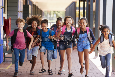 school kids running in elementary school