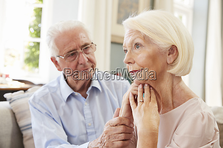 senior man comforting woman with depression