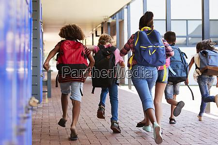school kids running in elementary school
