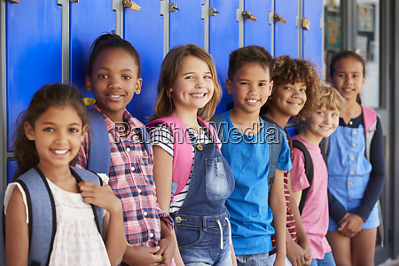school kids in front of lockers