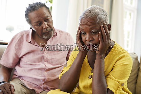 senior man comforting woman with depression
