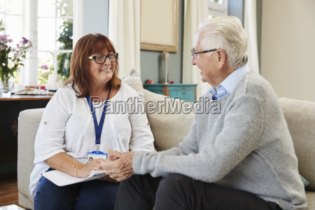 female support worker visits senior man