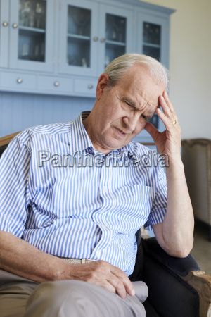 senior man sitting in chair at