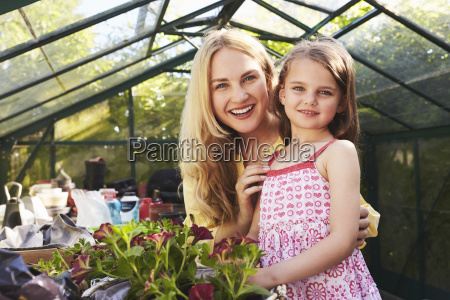 portrait of mother and daughter planting