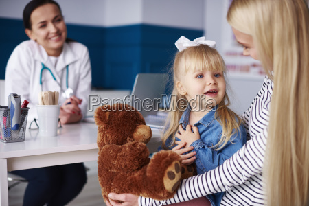 mother with girl and teddy in