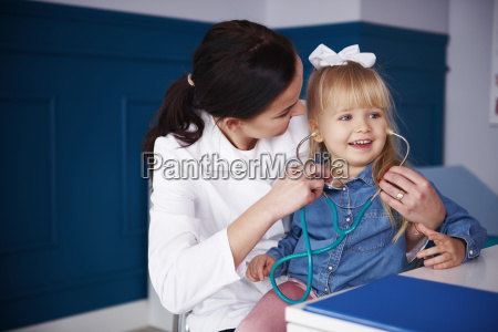 doctor and girl playing with stethoscope