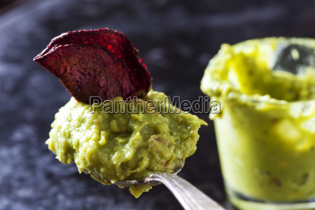 spoon of guacamole and betroot chip