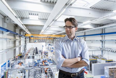 confident businessman on factory shop floor