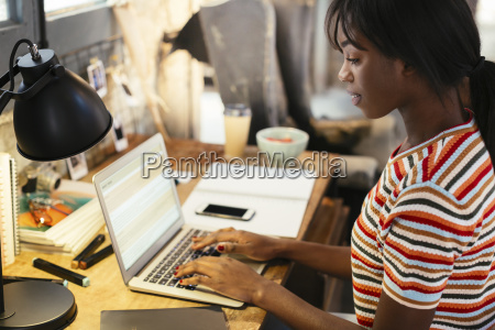 young woman sitting at desk working