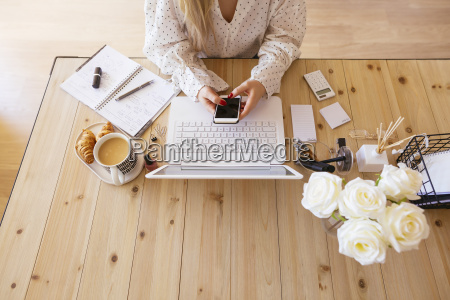 young woman sitting at desk using