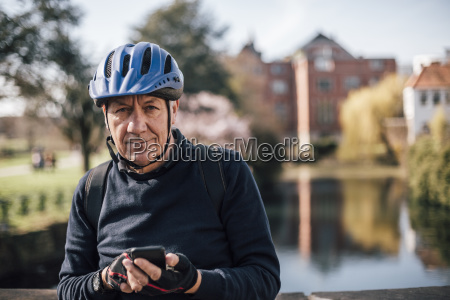 portrait of senior man with cycling