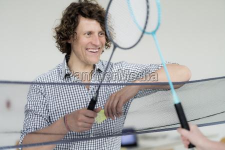 businessman winning badminton game in the