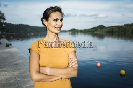 portrait of smiling woman standing on