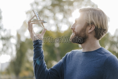 man in autumnal park looking at