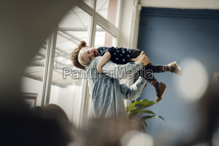 father and baby son having fun