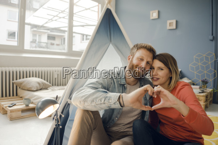 happy couple at home camping ina