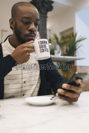 man with cup of coffee in
