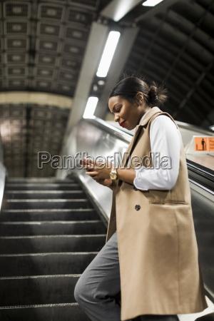 uk london smiling businesswoman standing on