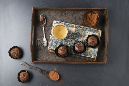small cupcakes with chocolate cream and