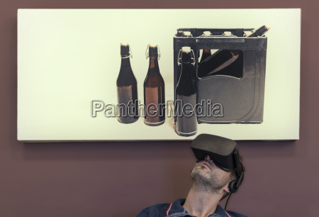 man wearing vr glasses under photography