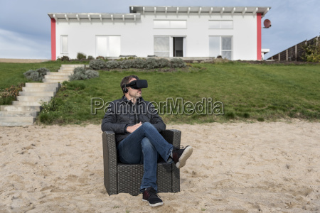 man sitting in armchair on the