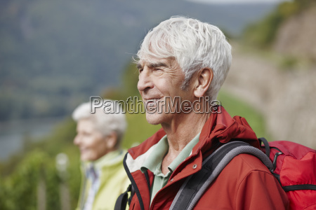 portrait of senior man with backpack